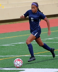 Dunwoody's Sarah Holland and her teammates travel to No. 3 Dacula for a Class 6A state playoff match. (Photo by Mark Brock)