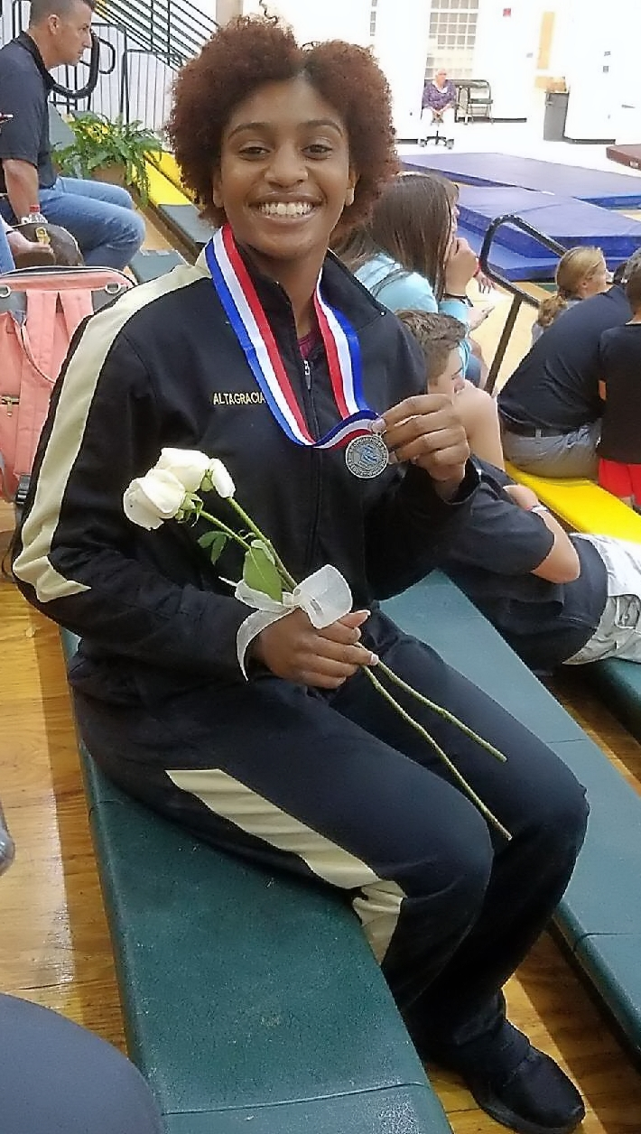 Tucker's Gina Frazier is a state silver medalist in the floor exercise.