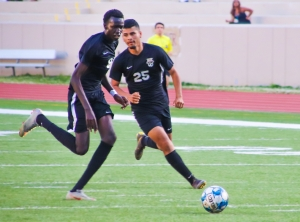 Tucker's Chol Chol (8) and teammate Carlos Castro (25) cross each other's path during first half action of their 1-0 win over No. 10 Greenbrier on Thursday night. (Photo by Mark Brock)