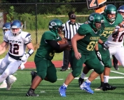 Cross Keys lineman Bryan Guerrero (61) leads the way for running back Roy Huff (34 with ball). (Photo by Mark Brock)