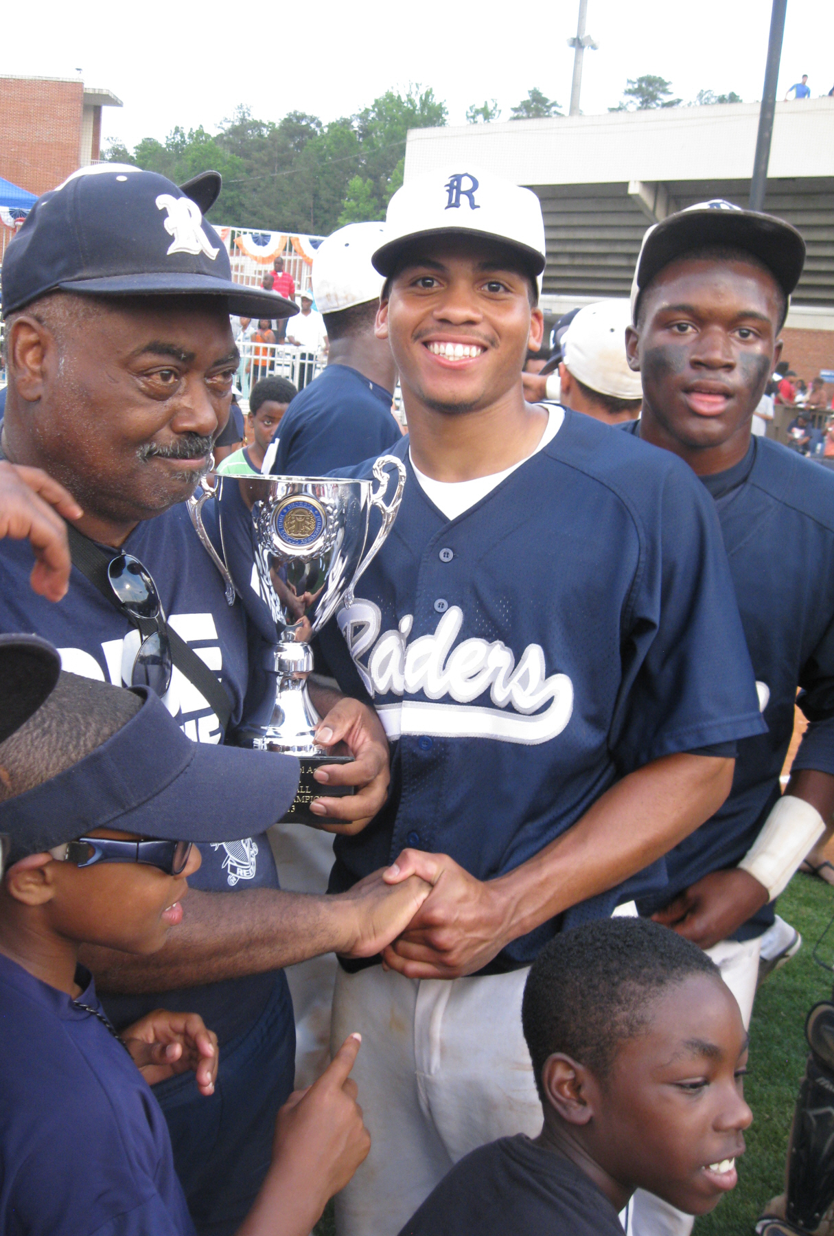 Marvin Pruitt and pitcher Brandon Baker celebrate the Raiders' 2013 Class 4A State Championship win over Marist.