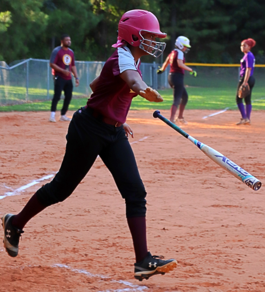 Tucker's Mattie Jenkins drew a bases-loaded walk to drive in one of the Tigers' two runs. (Photo by Mark Brock)