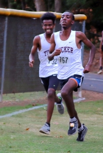 Tucker's Yeshak Ergano (left) and teammate Zinabu Marcus (right) are running for a repeat in the Angora Invitational at Druid Hills Middle on Saturday. (Photo by Mark Brock)