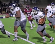 Cedar Grove offensive lineman Gregory Slaton (55) leads 1,000 yard rusher Chavon Wright down the field. The pair help the Saints in a key Region 5-3A contest against Pace on Friday night. (Photo by Mark Brock)