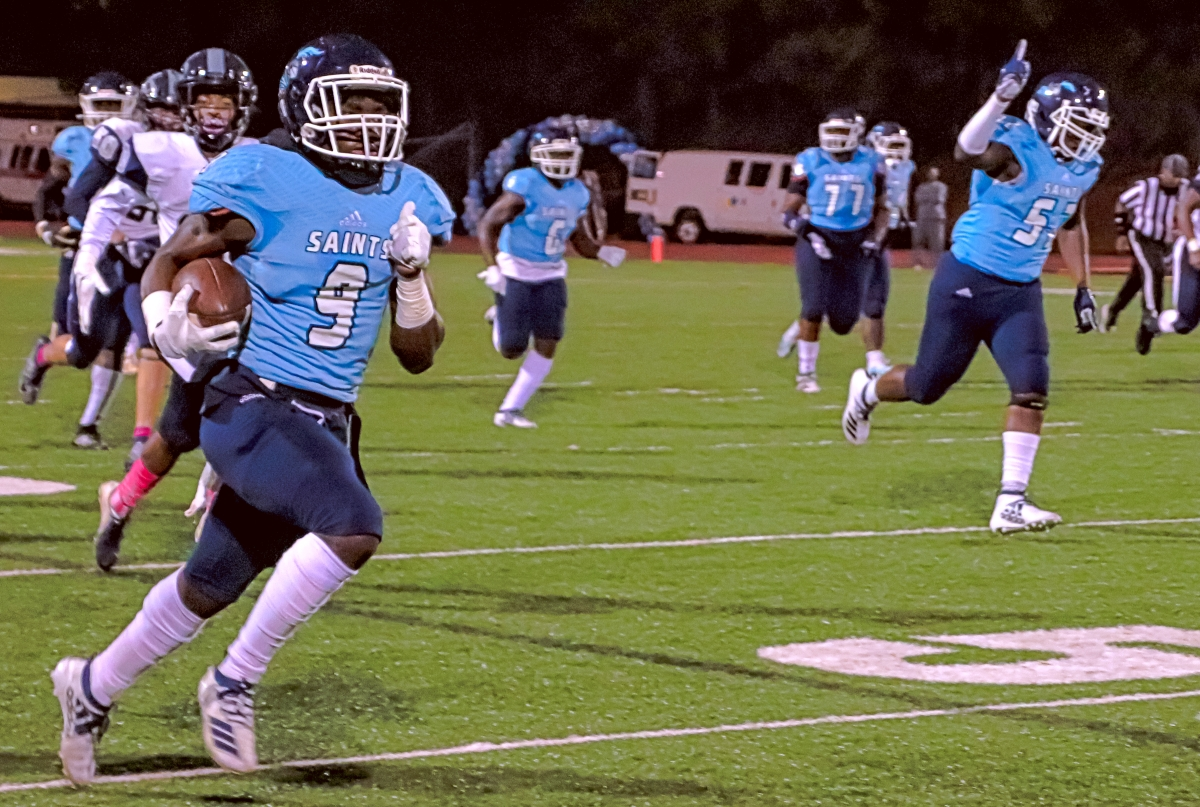 Cedar Grove's Jordan Grier (9) returns a fumble 70 yards in the first half of the Saints 40-10 win over Pace on Friday night. (Photo by Mark Brock)