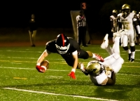 Druid Hills receiver Graham Connell (with ball) dives through a Salem defender into the end zone on the first of his two 22-yard touchdown receptions on passes from Sterling Knowles against the Seminoles. (Photo by Mark Brock)