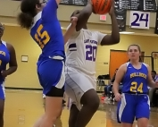 Chamblee's Kristina Perez (15) defends inside against Miller Grove's Maya Berry (20) during first half action in Miller Grove's win. (Photo by Mark Brock)