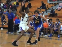 Miller Grove's Michael Lewis (30) tries to cut off Chamblee's Will Mepham (23) as he goes baseline during Miller Grove's win on Tuesday. (Photo by Mark Brock)