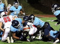 Cedar Grove defensive lineman Brandon Hall (77) and defensive back Latrelvin Blackemore (14) make a big first down stop inside the 10-yard line against GAC. The play was the first of three that kept GAC from taking the lead or tying the game with less than 5 minutes to play. (Photo by Mark Brock)