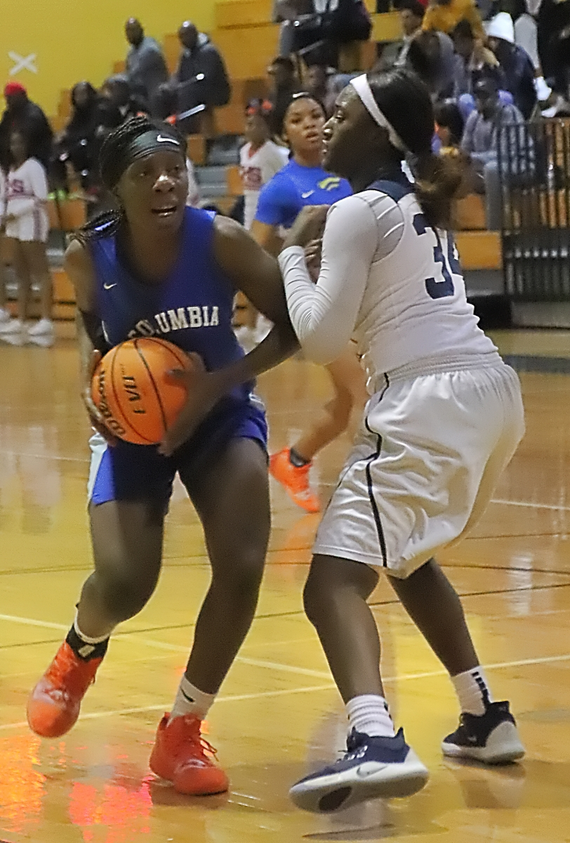 Columbia's Elese Warren (with ball) works inside against Southwest DeKalb's Aniyah Lee (34). Warren had an 11-point, 10 rebound double-double in the game won by Lee and her Lady Panther teammates 44-42. (Photo by Mark Brock)