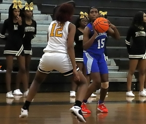 Columbia's Daija Carr (15) lines up for a three-poionter as Zaryana Mitchell (12) defends. during first half acdtion of Columbia's double-overtime win. (Photo by Mark Brock)