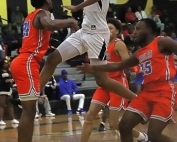 Lithonia's Franklin Champion (with ball) flies to the basket against Columbia's Devin Longstreet (24) and Nigel Emile (25) during the No. 1 ranked Bulldogs big win. (Photo by Mark Brock)