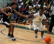 Arabia Mountain's Chase Ballard (3) drives against Southwest DeKalb's Jacorry Gist (0). Ballard had a valiant effort with 21 points, but the Rams fell 65-52 to the Panthers. (Photo by Mark Brock)