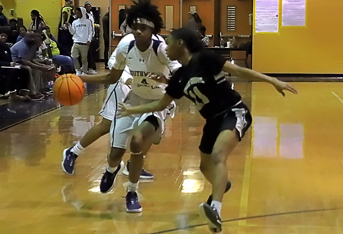 Southwest DeKalb's Pyria Thompson (4) drives against Miller Grove defender Jalisha Mann (11) in the Lady Panthers' 10th Region 5-5A victory. (Photo by Mark Brock)