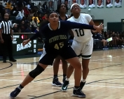Southwest DeKalb's Taylor Christmas (45) blocks out against Arabia Mountain's Sydney Bunkley (10). Christmas hit for 15 points and grabbed eight rebounds in her team's 72-57 win. (Photo by Mark Brock)