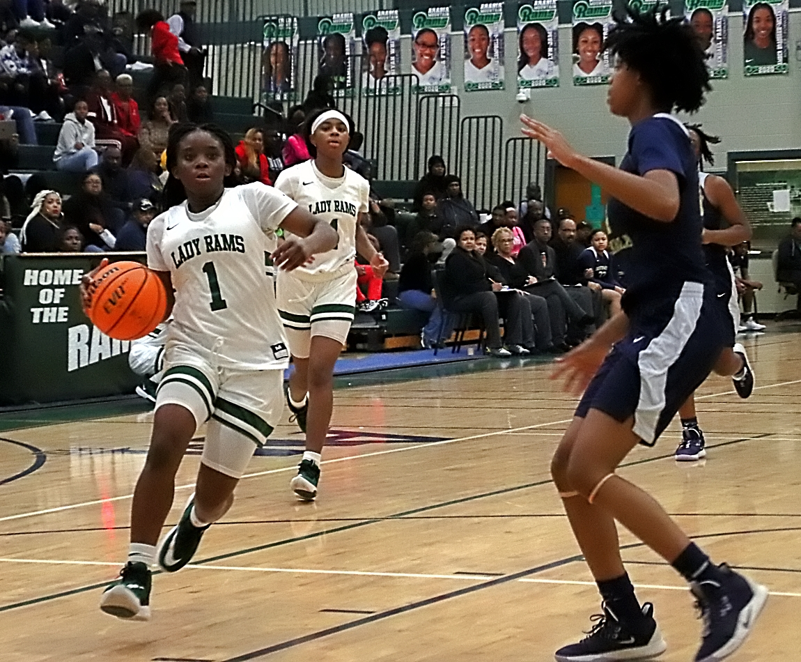 Arabia Mountain's Myoria Pruitt (1) and Southwest DeKalb's Pyria Thompson (4) both get to play home playoff games on Friday. (Photo by Mark Brock)