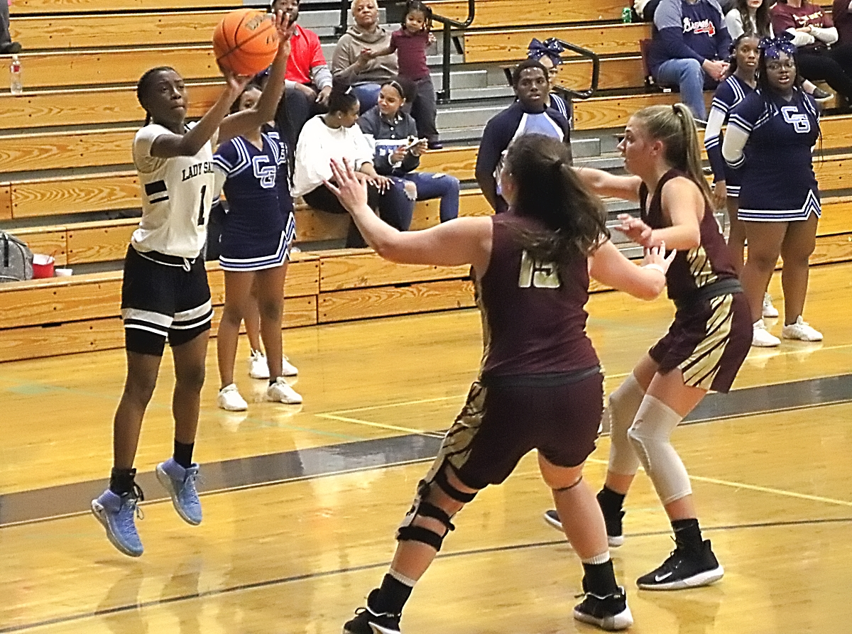 Cedar Grove's Rickayla Johnson (1) shoots a big three-pointer over Dawason County's Marlie Townley (15) during the second half come-back win for the Lady Saints. (Photo by Mark Brock)