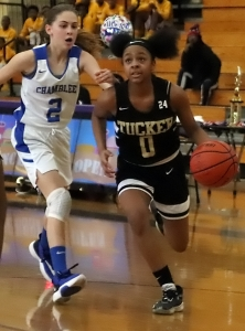 Tucker's Malaya Jones (0) drives past Chamblee's Mackenzie Cassidy (2). Jones scored 30 points on the way to MVP honors. (Photo by Mark Brock)