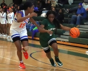 Arabia Mountain's Myoria Pruitt (1) turns the corner against Columbia's Daija Carr in the Lady Rams 52-39 win over the Lady Eagles. (Photo by Mark Brock)