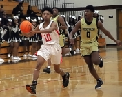 Druid Hills Avery Covington (10, shown here against McDonough earlier this season) hit some clutch free throws to lead the Red Devils to a playoff clinching 45-44 win over No. 3 seed Salem at McDonough on Monday. (Photo by Mark Brock)