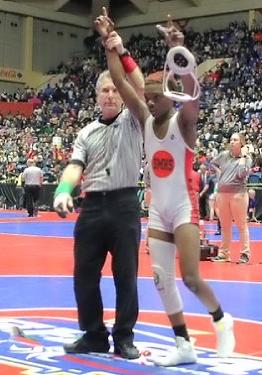 Stone Mountain freshman tops season with GHSA Traditional State Wrestling gold medal in the 106 weight class. (Photo by Lester Wright)