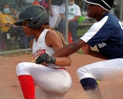 Druid Hills' Erielle Reid beats the tag of Arabia Mountain's Ashley Brown to score one of her three runs in the Red Devilsl' 8-1 Region 6-4A victory on Thursday. (Photo by Mark Brock)