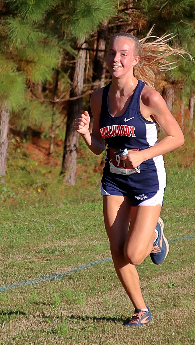 Dunwoody freshman Claire Shelton finished fourth in the Class 7A Girls' State Cross Country Meet on Saturday with a DeKalb girls' best time of 19:46.11. (Photo by Mark Brock)