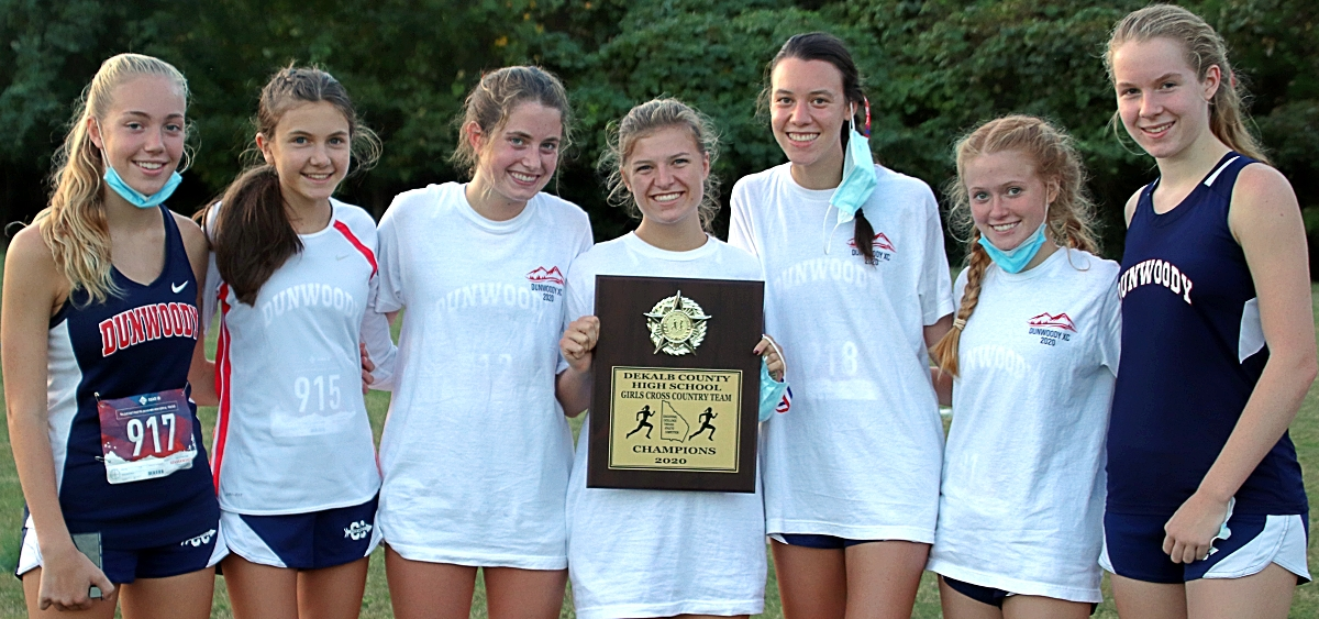 The Dunwoody Lady Wildcats captured the 2020 DCSD Cross Country Championship at Arabia Mountain. (Photo by Mark Brock)