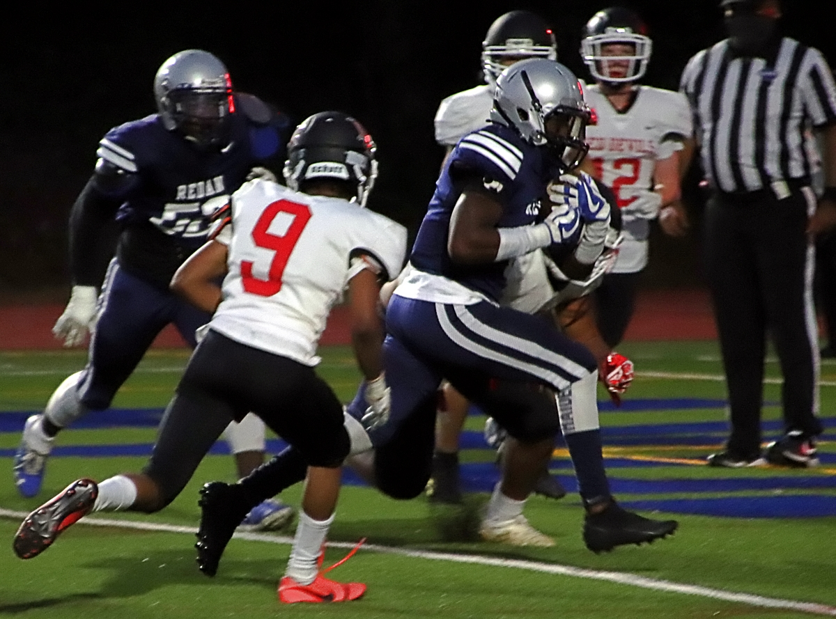 Redan's Votarres Thaxton goes into the end zone for a Raider touchdown before Druid Hills Townes Purdy (9) could make the play. (Photo by Mark Brock)