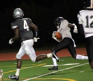 Stone Mountain's Shaheim Bailey (with ball) weaved his way 24 yards for the Pirates lone touchdown in the 48-7 loss to M.L. King on Saturday night. (Photo by Mark Brock)