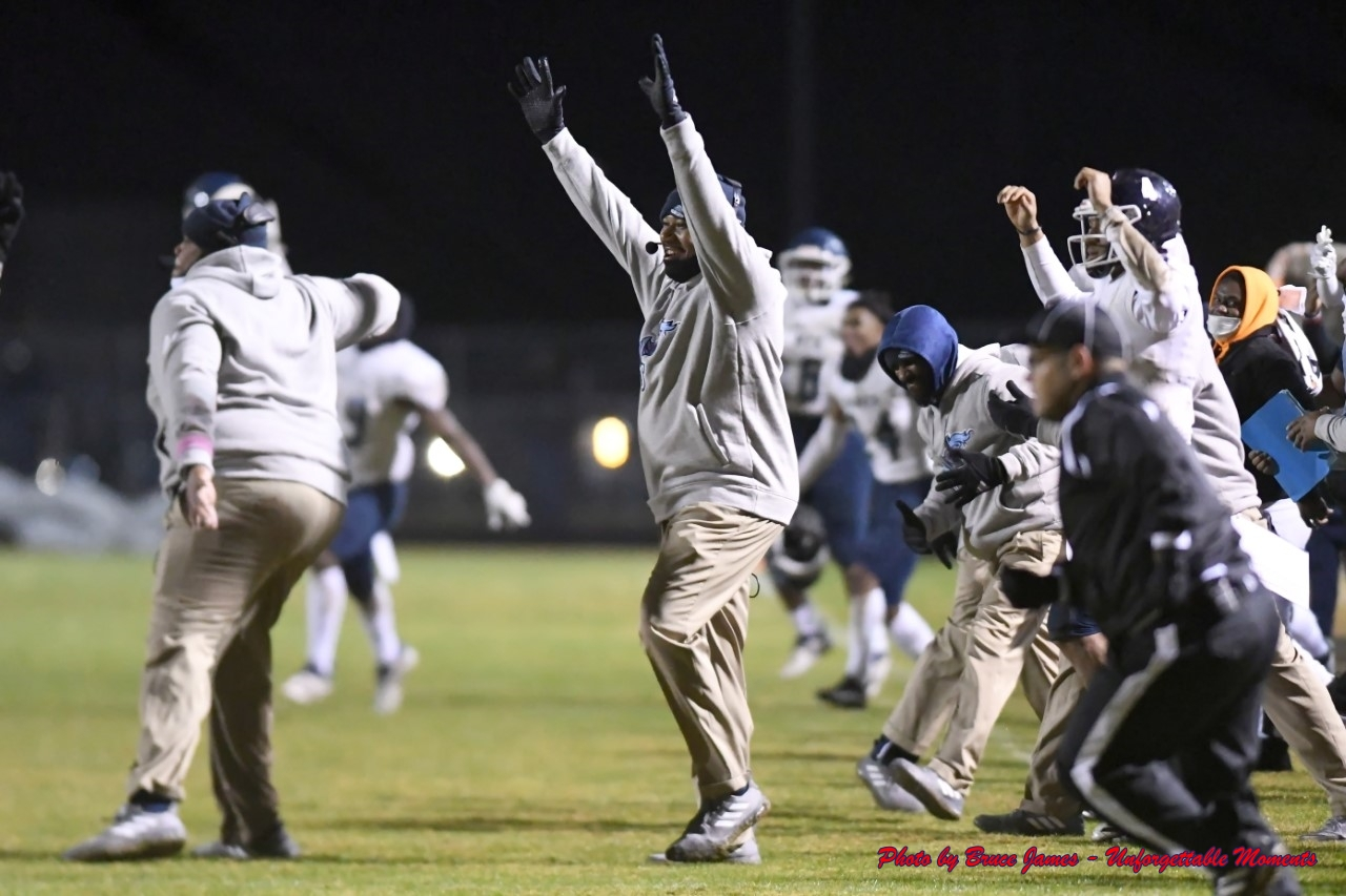 Cedar Grove Head Coach Miguel Patrick and his Cedar Grove coaches and players celebrate Rashod Dubinion's game winning touchdown in a three-overtime playoff win at Rockmart. (Photo by Bruce James)