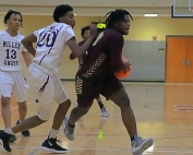 Tucker guard Raylan Barrian (with ball) gets past Miller Grove defenders Tyreik Boyd (13) and Matthew McCullum (20) for a fourth quarter basket in the Tigers 61-59 thriller. (Photo by Mark Brock)