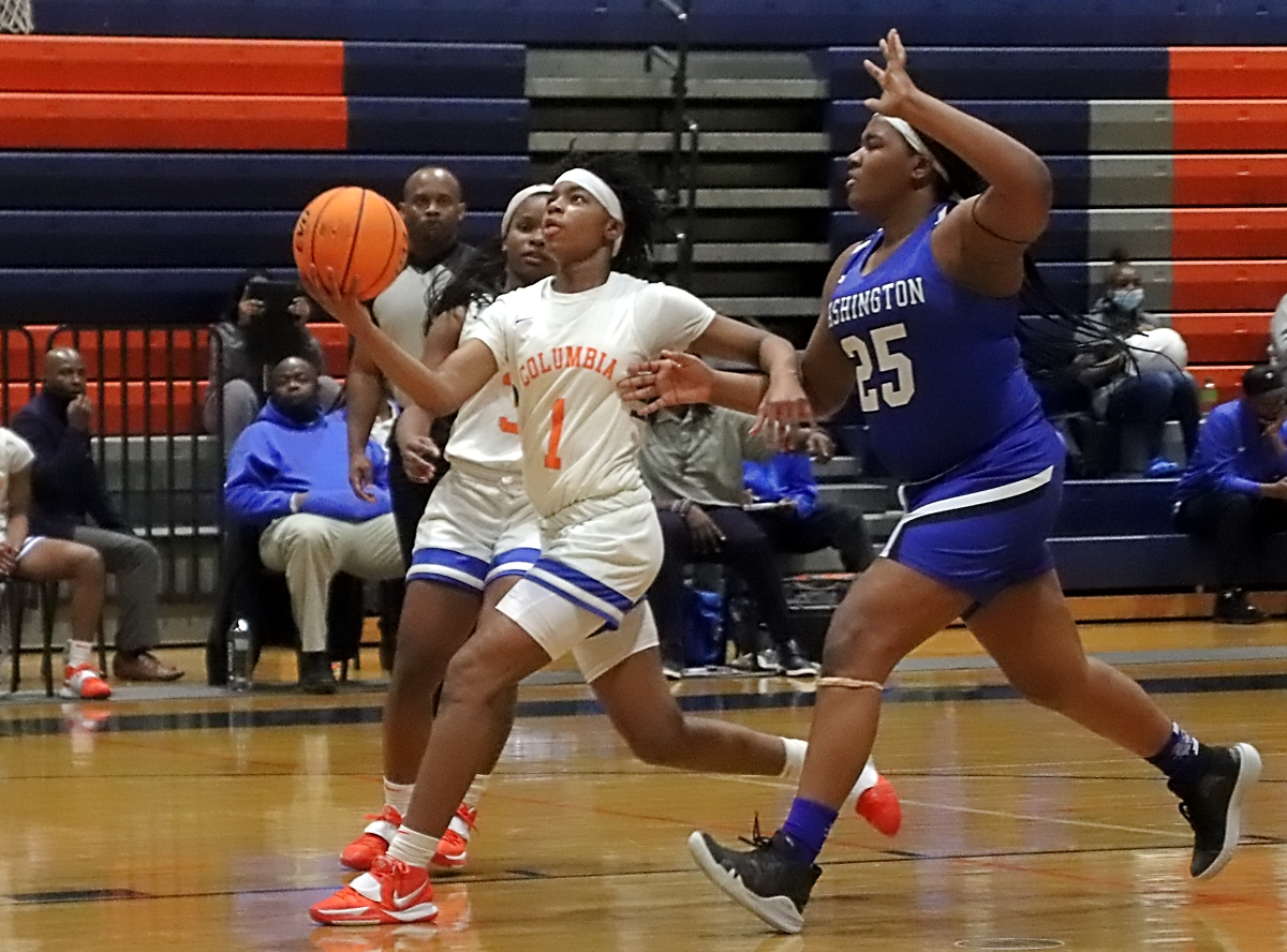 Columbia's Keyonna Giles (1) goes up for a layup against Washington's A. Tickles (25) in Columbia's 72-5 win on Tuesday. (Photo by Mark Brock)