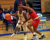 Dunwoody's Mekhi McKinney (1) is fouled as he drives past a Berkmar defender. (Photo by Mark Brock)
