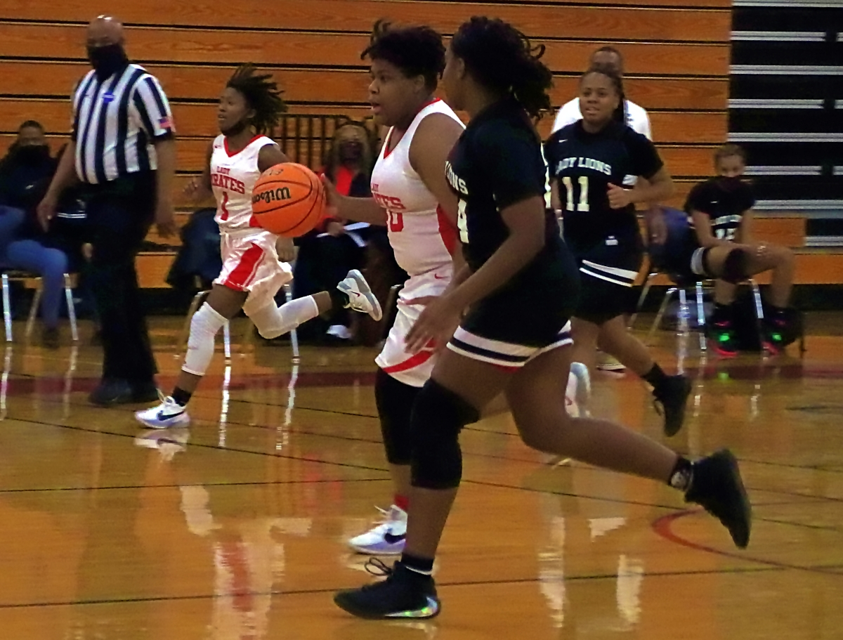 Stone Mountain's Kyra McCrary (40) races up court against Martin Luther King Jr.'s Jana Berry (24) in the third quarter of King's 77-34 win. (Photo by Mark Brock)