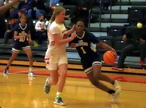 Redan's Carmen Cooper (1) drives the baseline against GAC's Molly Pritchard (00) during second half action of GAC's 81-41 Region 5-3A girls' semifinal win. (Photo by Mark Brock)