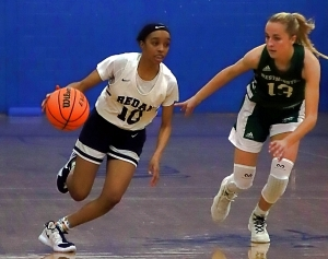 Redan's Jayla Cook (10) dribbles past Westminster's Evelyn Shores (13) during Redan's hard fought 43-38 loss to the No. 6 Lady Wildcats. (Photo by Mark Brock)
