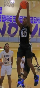 Stephenson's Jaylen Peterson pulls down one of his 10 rebounds in the Region 6-4A boys' championship game at Miller Grove. (Photo by Mark Brock)
