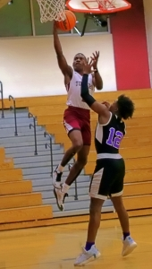 Towers' Zakevias Mathis hits a layup in second half action against KIPP's Niles Washington (12). Mathis had a game-high 22 points in a tough 45-44 loss to end the Titans' season. (Photo by Mark Brock)