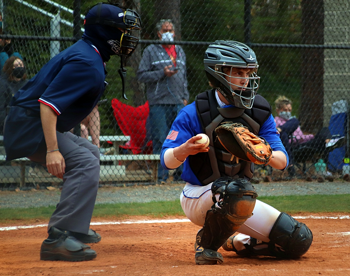 Chamblee catcher Isaac Harkins checks a runner at first during action against Decatur. (Photo by Mark Brock)