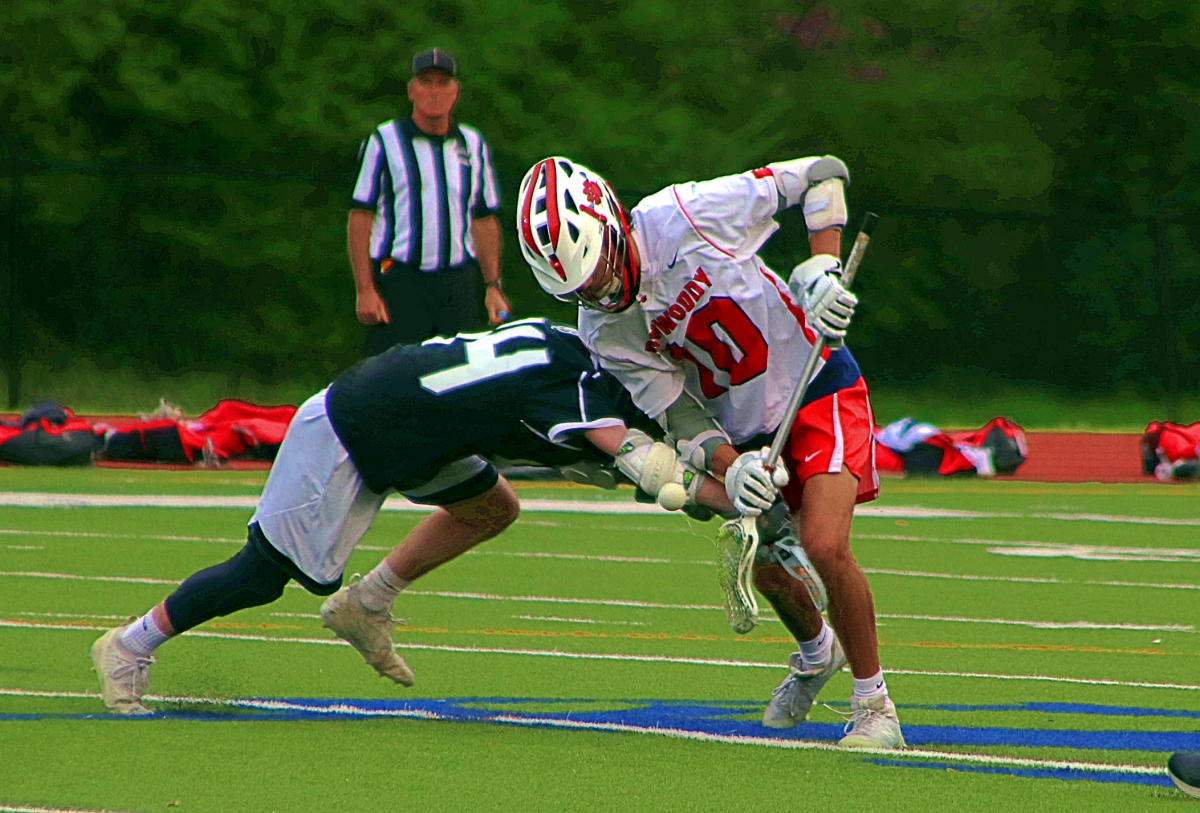 Dunwoody's Casey Blum (10) battles for the faceoff during the Wildcats' 8-6 win over North Atlanta. (Photo by Mark Brock)