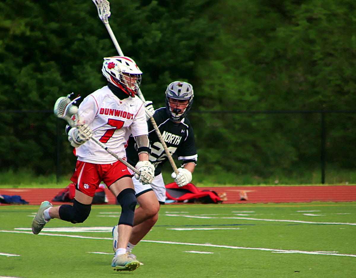 Dunwoody's Zach Rosing scored six goals, including two in the final three minutes, to lead the Wildcats to an 8-6 Area 6A/7A victory over North Atlanta at Avondale Stadium on Friday night. (Photo by Mark Brock)