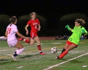 Druid Hills goalie Kaitlin Sinkler (13) comes out to stop a play by Druid Hills' Lily Garrigan (19) with help from teammate Maya Neuhas (8). (Photo by Mark Brock)