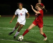 Dunwoody's Sarah Holland (5) battles Druid Hills Reese Rathur (7) for the ball during Dunwoody's 10-1 win earlier this season. The two teams head to the playoffs this week. (Photo by Mark Brock)
