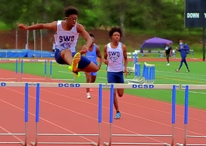 Southwest DeKalb's Isaiah Taylor swept the Region 5-5A hurdle events to lead the Panthers to a second-place finish. (Photo by Mark Brock)