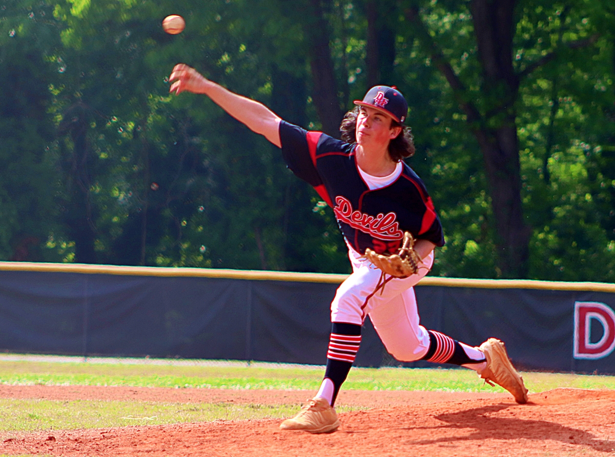 Druid Hills reliever Ian O'Connor set down seven consecutive Bruins during three innings o relief on he mound for the Red Devils in the 3-0 Game 1 loss (Photo by Mark Brock)