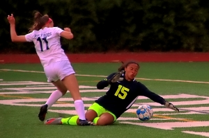 Dunwoody goalie Ella Holland (15) makes a diving save in front of Forsyth Central's Brielle LaBerge during Dunwoody's 3-1 Class 7A girls' state playoff win. (Photo by Mark Brock)