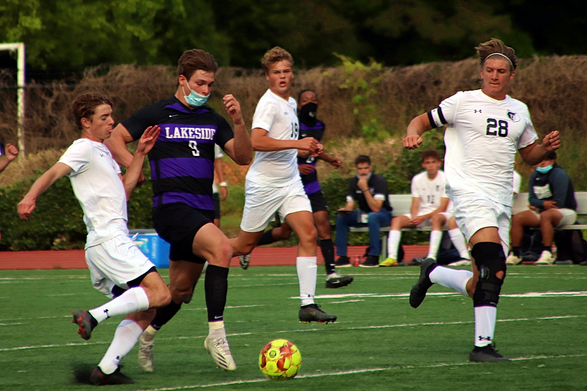 Lakeside's Zach Martin (9) shown here against Houston County scored the opening goal for the Vikings to jumpstart their 3 goal run in the second half of the 3-0 win over Glynn Academy in the second round of the Class 6A boys' state soccer playoffs. (Photo by Mark Brock)