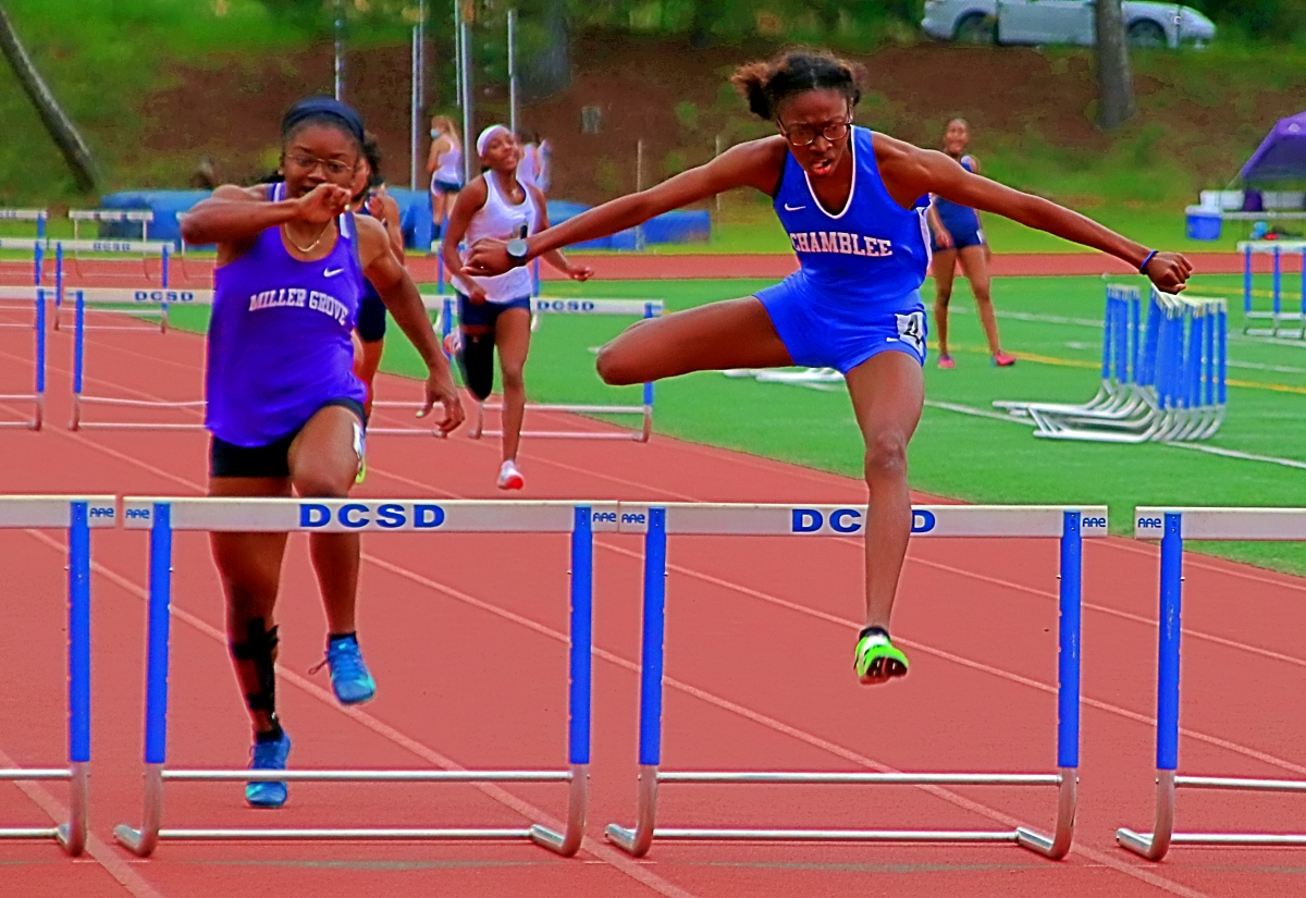 Chamblee's Ariel Raggs (right) won the 300-meter hurdles ahead of Miller Grove's Faith Hill. (Photo by Mark Brock)