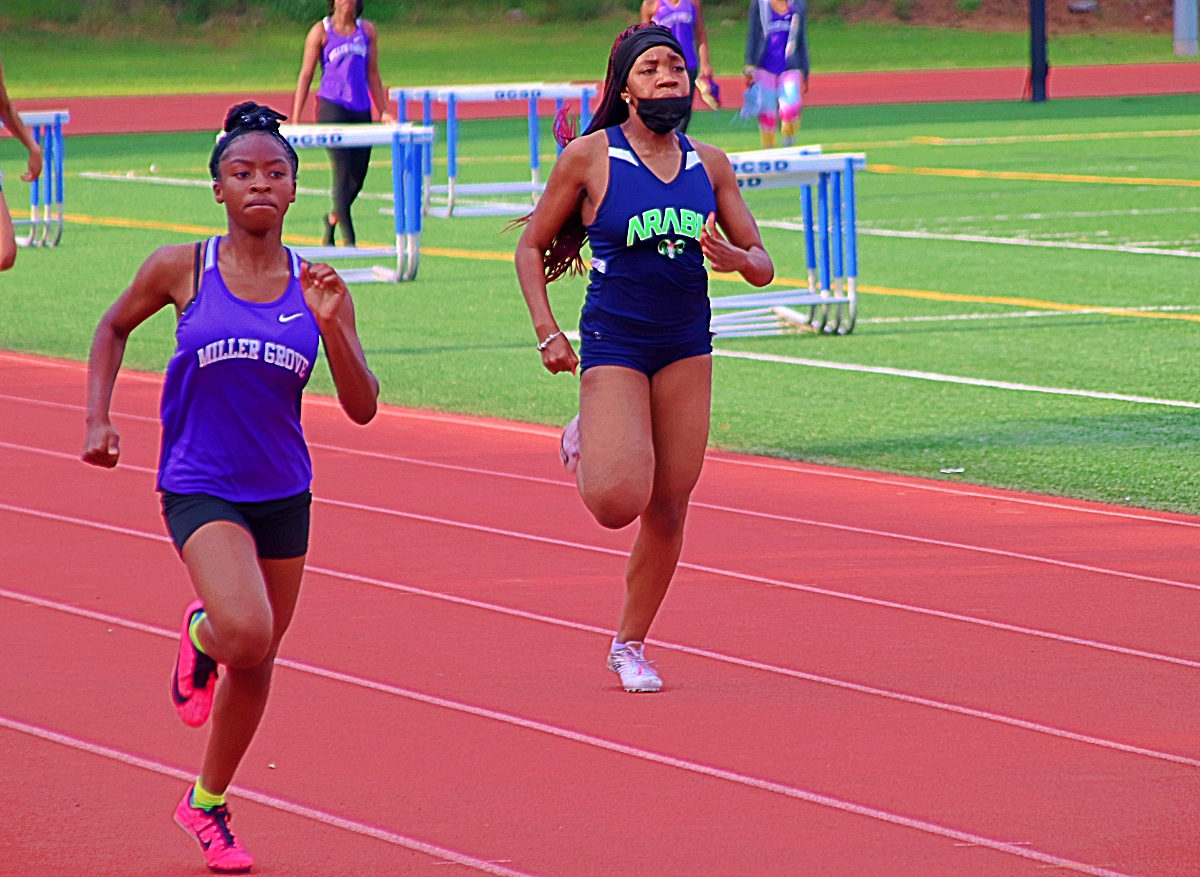 Miller Grove's Jocelyn Streeter (left) held off Arabia Mountain's Saige Hypolite for the 400-meter dash gold medal. (Photo by Mark Brock)